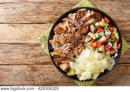 Kalua Pork Hawaiian Food Slowly Cooked And Served With Stewed Cabbage And Fresh Salad Close-up In A
