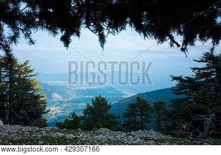Natural frame of coniferous trees, View from Lycian Way on Mediterranean coast from high mountain, Finike and Hasyurt, Turkey
