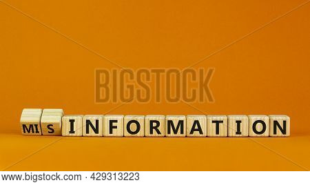 Information Or Misinformation Symbol. Turned Cubes And Changed The Word Misinformation To Informatio