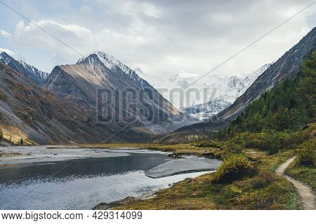 Scenic Landscape With Footpath Along Water Streams In Mountain Valley In Autumn Colors With View To