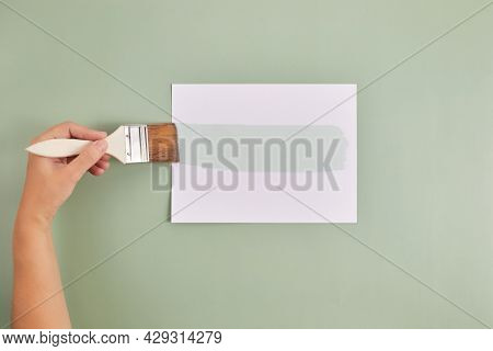 Happy Left Handers Day. Left Hand Hold Brush And Writing Text.