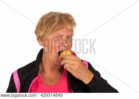 Old Fit sporty Healthy woman eating an apple isolated over white background