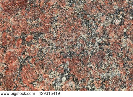 Red Granite Texture. A Variegated, Spotted Background Of Red (brown) Granite. The Stone Granite Surf