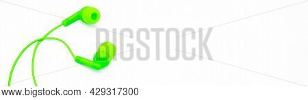 Banner With Green Earpods Basic In-ear Headphone Earbuds On White Background, Looks Like A Hug. Copy