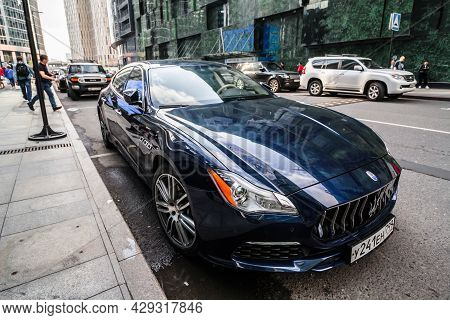 Maserati Quattroporte Vi M156 Blue Color In Front Of Modern Glass Buildings. Moscow , Russia - July