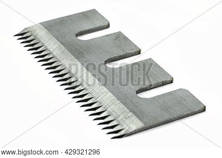 A Serrated Industrial Blade For Tape Cutters, Isolated On A White Background.
