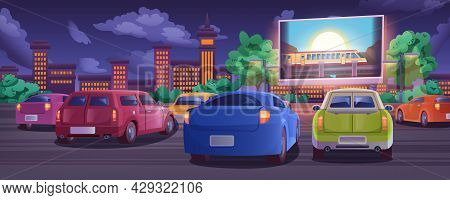 Car Street Cinema. Drive-in Movie Theater With Automobiles On Open Air Parking At Summer Night. Outd