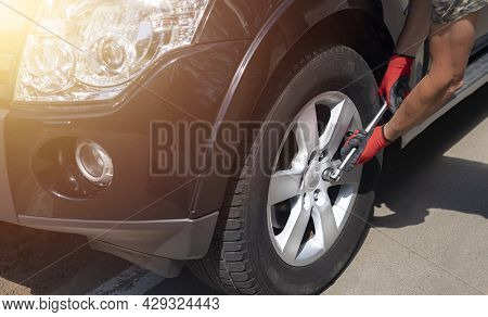 Fixing, Inspection And Checking Wheel Tyre Of Car With Manual Tool.
