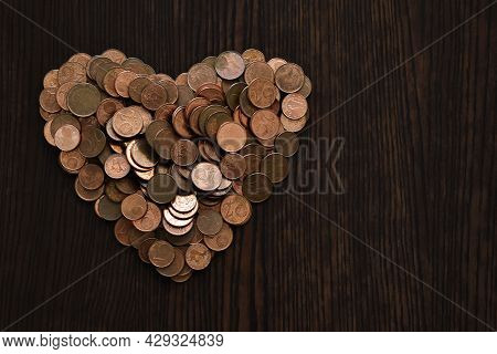 Euro Cent Coins In The Shape Of Heart.   Concept Of Money Lover And Valentines Day.  Copy Space Is O