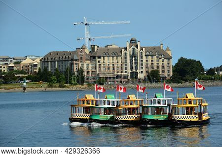 Victoria Bc, Canada, August 2nd 2021. Victoria Water Taxi\'s Play In The Inner Harbor In Victoria Bc
