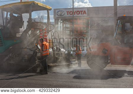 Tula, Russia - May 16, 2021: Process Of Asphalting, Asphalt Paver Machine And Road Roller During Roa