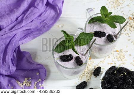Dessert With Yogurt And Chia Berries On A White Plate