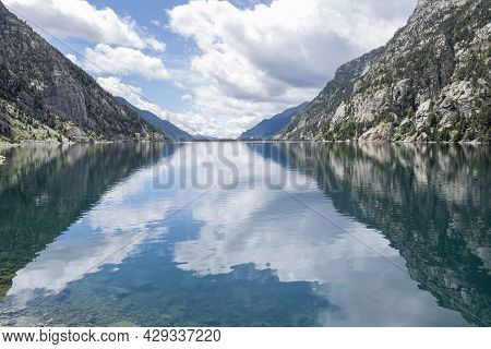Cavallers Reservoir Surrounded By High Mountains Reflected In The Water, River Noguera De Tor In Rib