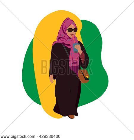 A Beautiful Muslim Woman In A Hijab In Everyday Life. A Turkish Woman In A Traditional Style Of Clot