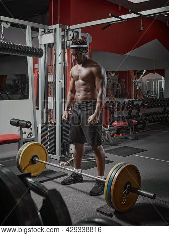 African American Sports Guy With Muscular Torso Training With Barbell In Gym. Weightlifting, Strengt