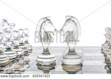 Glass Chess Pieces Is Standing On Board In White