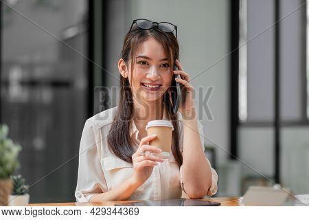Portrait Of Young Asian Businesswoman Beautiful Charming Smiling And Talking On The Mobile Phone In