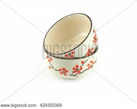 Empty Stack Beige Ceramic Bowl With Brown Rim And Red Flora Pattern Isolated On A White Background.