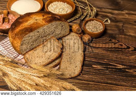 Fresh Homemade Rustic Wholegrain Bread. Homemade Bread With Sunflower Seeds On The Kitchen Table. Tr