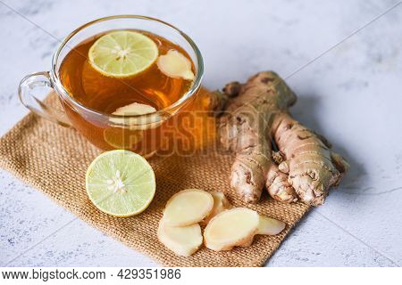 Hot Ginger Juice In Glass And Slices Ginger Root Herbal Juice Tea, Ginger And Lemon Fresh Cocktail