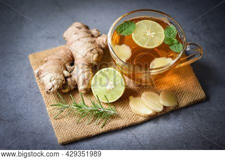 Hot Ginger Juice In Glass And Mint With Slices Ginger Root Herbal Juice Tea Rosemary, Ginger And Lem