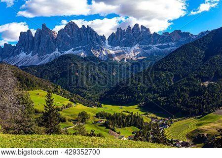 Dolomites on a sunny autumn day. Europe, Val de Funes, sunny bright day. The world's most beautiful village in the Dolomites: Santa Maddalena