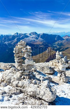 Commemorative stone pyramid. Pordoi is a mountain pass of the Dolomites. South Tyrol. Italy. The Passo-Pordoi pass separates the province of Trento from the province of Belluno.