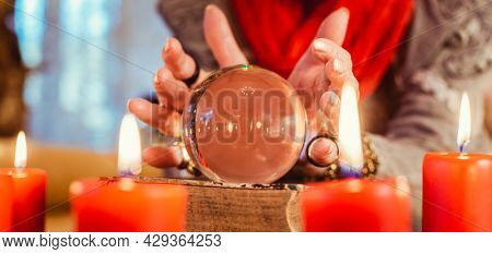 Soothsayer during a Seance with Crystal ball