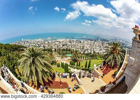 HAIFA, ISRAEL - MAY 6, 2017: Pilgrimage center and popular tourist destination. Bahai Center on Mount Carmel. Sunny day by sea. Gorgeous colorful gardens, flower beds and green lawns