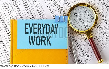 Everyday Work Text On Sticker On Notebook With Magnifier And Chart. Business