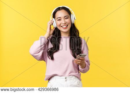 People Emotions, Lifestyle Leisure And Beauty Concept. Happy Smiling Asian Woman Listening Music In