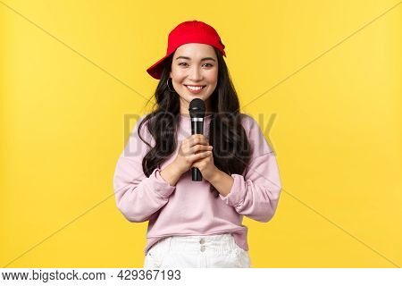 People Emotions, Lifestyle Leisure And Beauty Concept. Cute Smiling Asian Woman Performer Singing So