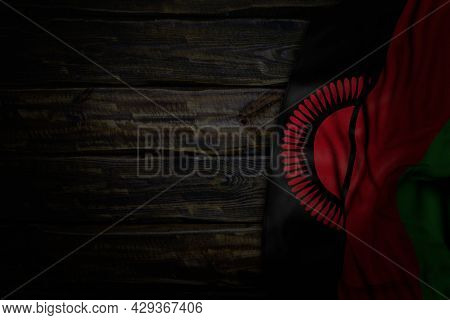 Cute Dark Illustration Of Malawi Flag With Big Folds On Old Wood With Empty Place For Text - Any Occ
