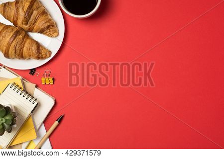 Top View Photo Of Workstation Plant On Stack Of Notebooks Binder Clips Pen Plate With Fresh Croissan
