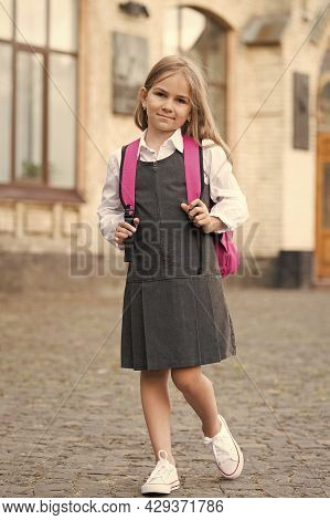 Little Child In Formal Uniform Dress Go To School Carrying Bag, Back To School