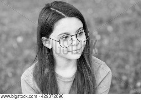 Little Girl Wear Vintage Rim Eyeglasses Green Lawn Background, Eyes Health Concept
