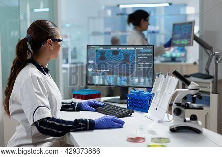 Researcher Biochemist Woman Analyzing Virus Expertise Working On Coronavirus Treatment In Microbiolo