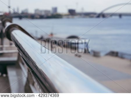 Steel Railings Fencing On The River Embankment In The City. Shiny Chrome Metal Fencing And Railings