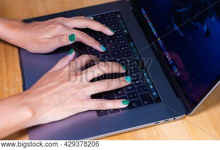 Cyberjaya, Malaysia - October 13, 2020:  Woman Hands Typing On A Computer Keyboard. Female Hands Wri
