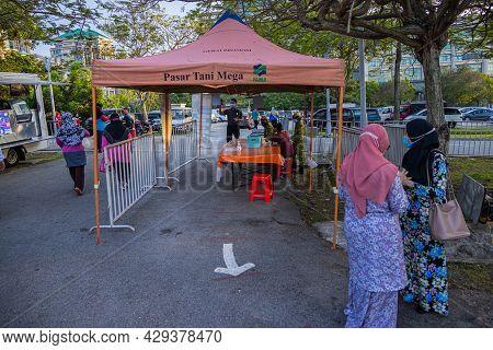 Putrajaya, Malaysia - October 09, 2020: Entry Control With Smartphone App And Temperature Measuremen