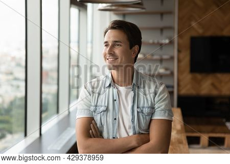 Portrait Of Happy Pensive Businessman In Casual Looking At Window