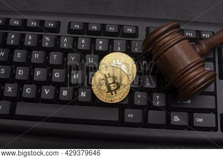 Cryptocurrency Bitcoin With Hammer On Keyboard. Dispute Resolution On Bitcoin Frauds