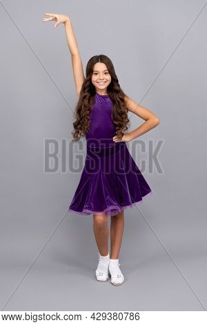 Happy Kid With Long Curly Hair In Dance Pose Wear Ballroom Dress Full Length, Dance Pose