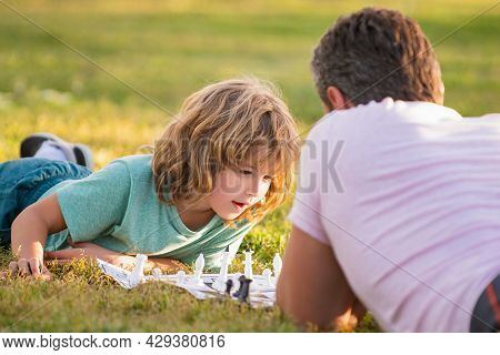 Parenthood And Childhood. Checkmate. Spending Time Together. Strategic And Tactic.