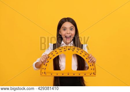 Measuring And Sizing. Education For Child. Mathematics. Amazed Teen Girl Hold Protractor