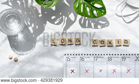 Text Long Covid, Wooden Letters. Weekly Planner, Calendar With All Day Schedules Crossed Out. Cancel