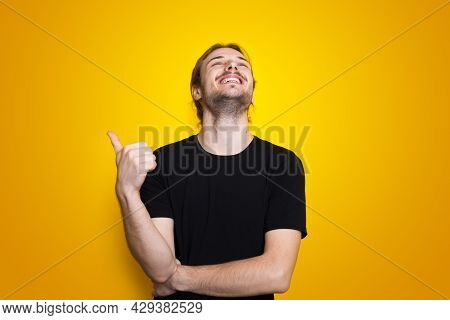 Man Posing On Yellow Wall. Positive Person. Gesturing The Like Sign. Like It.