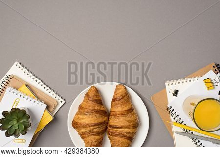 Top View Photo Of Workstation Stationery Stacks Of Notepads Binder Clips Pencil Pen Plant Glass Of O