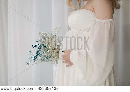 Middle Celection Of Pregnant Woman In White Dress Put Her Hand On Belly
