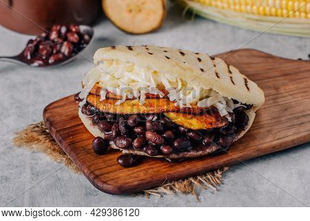 Typical Venezuelan Arepa, Made With Fried Plantain, Black Beans And Cheese